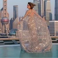Stiri despre Filme - Cum a fost imbracata Emma Watson la premiera filmului Frumoasa si Bestia din Shanghai