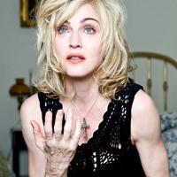 Stiri din Muzica - Varsta Madonnei comparata intre aspectul fetei si al mainilor