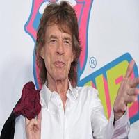 Stiri din Muzica - Prima fotografie cu cel de-al optulea copil al lui Mick Jagger